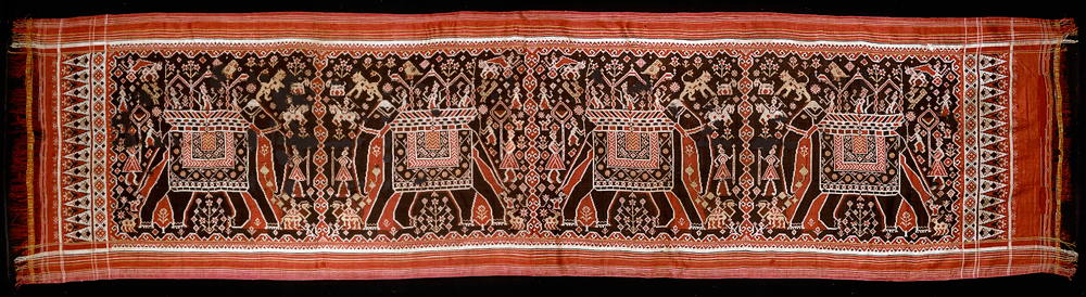 A black ground, red silk double ikat patolu with four caparisoned elephants